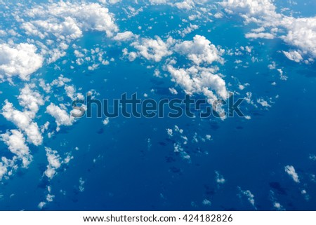 Cloudscape look out from airplane window over Australia with HDR tone - stock photo