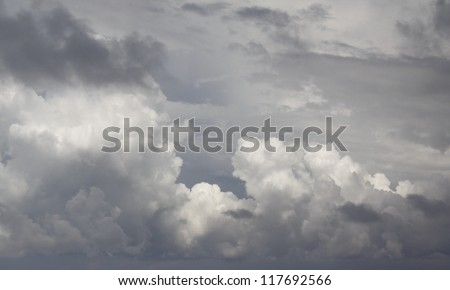 cloudscape of dark fluffy clouds - stock photo