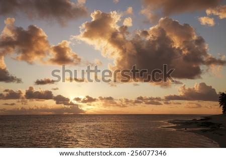 Cloudscape over Ocean and Island at Sunset - Rarotonga, Cook Islands, Polynesia - stock photo