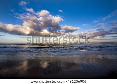 Cloudscape reflected in the sea