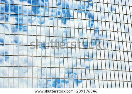 Cloudscape reflected on building windows. Abstract shot and textures. - stock photo