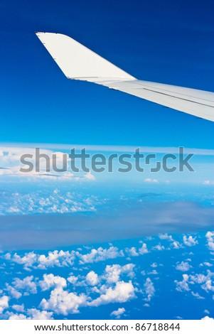 Cloudscape Sky Plane - stock photo