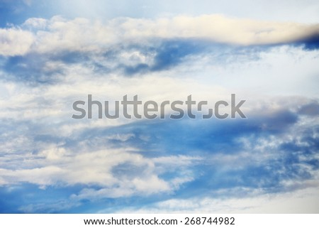 cloudscape with stratocumulus clouds at sunny day - stock photo