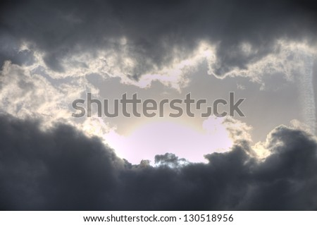 Cloudscape with sunbeams - stock photo