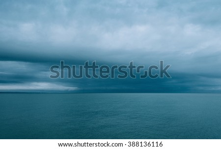 Cloudy and minimalist seascape, film emulation filter applied - stock photo