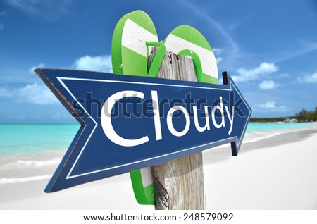 CLOUDY beach sign - stock photo