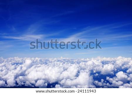 Cloudy blue sky on a sunny day. - stock photo