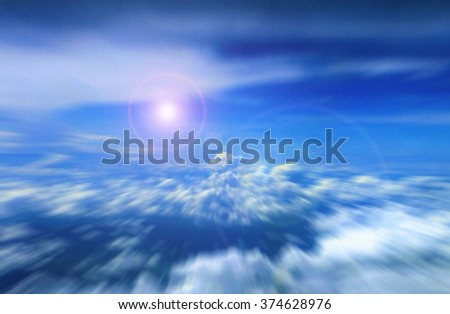 Cloudy blue sky with bright sunlight - stock photo