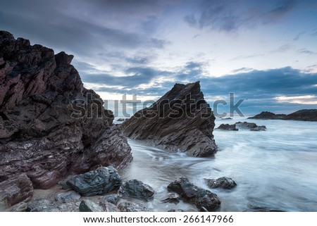 Cloudy dusk at Whitsand Bay in Cornwall - stock photo