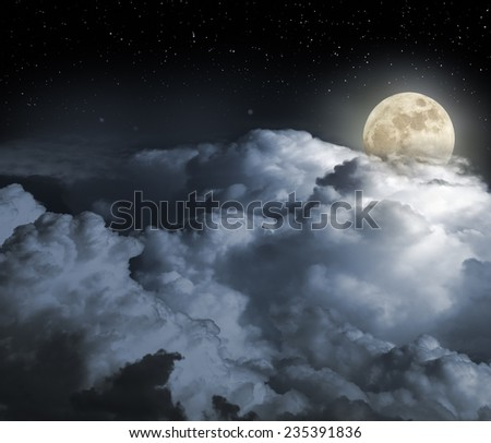 Cloudy full moon night as seen from above - stock photo