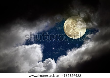 Cloudy full moon night with stars - stock photo