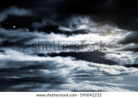 Cloudy full moon sky with stars - stock photo