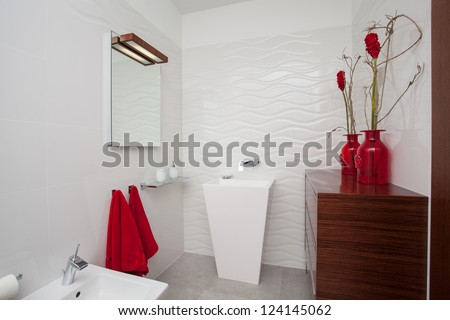 Cloudy home - white bathroom with red decoration - stock photo