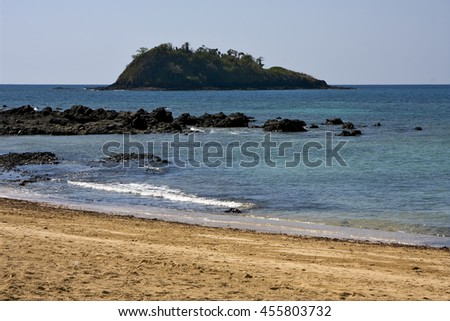 cloudy isle people palm  rock stone branch hill lagoon and coastline in madagascar nosy be nosy faly - stock photo