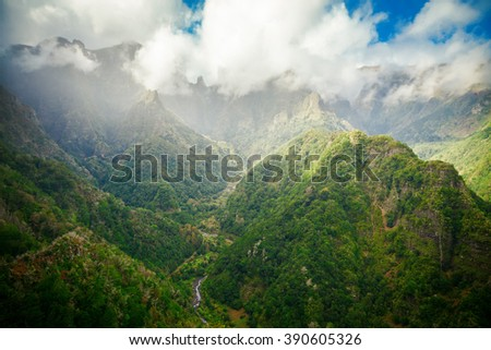 cloudy landscape with Madeira's peaks from levada Balcoes, Portugal