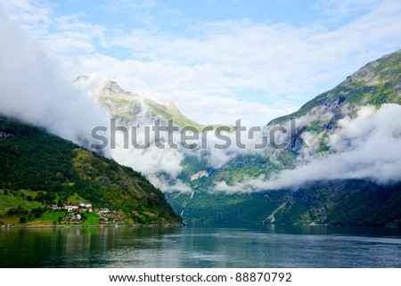 Cloudy morning in Geirangerfjord, Norway (listed as a UNESCO World Heritage Site) - stock photo