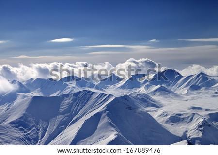 Cloudy mountains at evening. Caucasus Mountains, Georgia, view from ski resort Gudauri. - stock photo