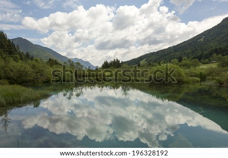 Cloudy reflection in spring of river Sava - stock photo