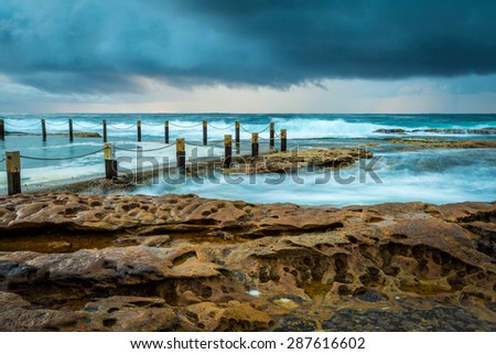 Cloudy seascape at Maroubra rock pool, Sydney, Australia. - stock photo