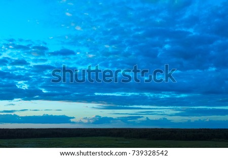 Cloudy skies and horizon. Infinite space and look into the atmosphere