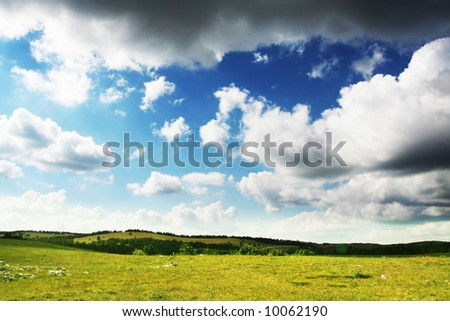 cloudy sky and mountain meadow