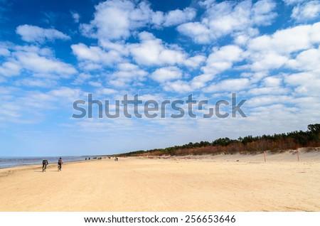 Cloudy sky and sandy beach of Baltic sea near Riga - stock photo