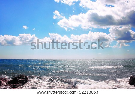 Cloudy sky and sea in evening time. - stock photo