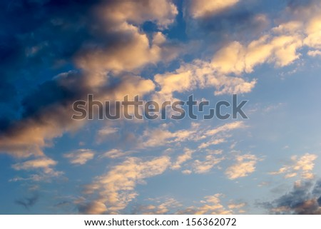 Cloudy sky in the evening sun - stock photo