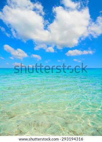 cloudy sky over Alghero clear water, Sardinia - stock photo