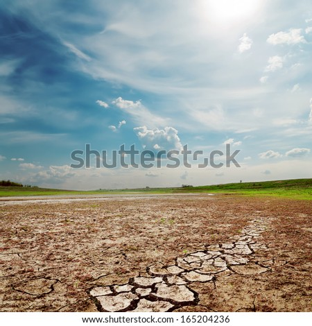 cloudy sky over drought land - stock photo