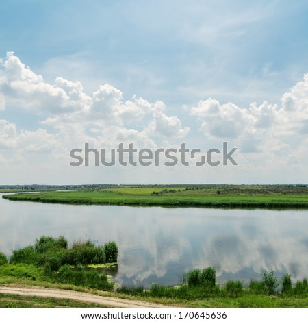 cloudy sky over river - stock photo