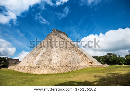 Cloudy sky over the ancient mayan pyramid of Ushmal in Mexico - stock photo