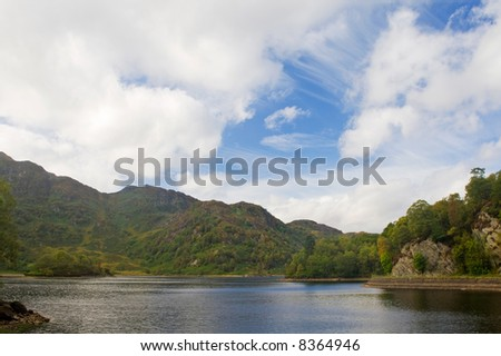 Cloudy sky over the Loch Katrine in Scotland - stock photo