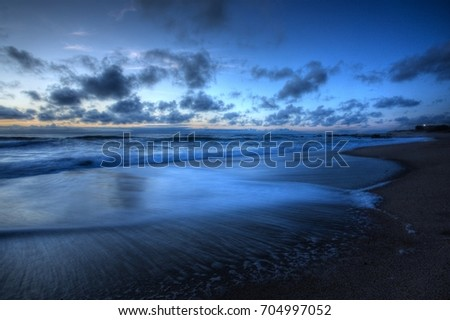 Cloudy sky reflecting in sea