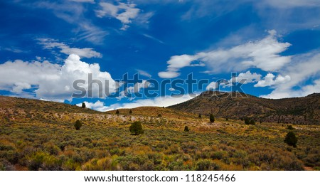 Cloudy Sky with Mountain in the Foreground - stock photo