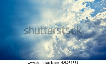 Cloudy sky with sun rays, nature background - stock photo