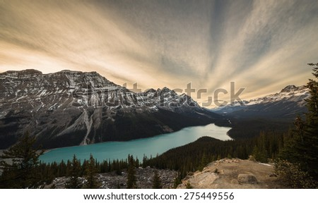 Cloudy sunset at Peyto Lake and Caldron Peak in the Mistaya River Valley in Lake. Banff National Park, Alberta, Canada - stock photo