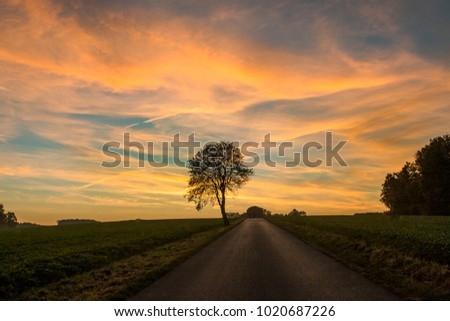 cloudy sunset over a rural landscape