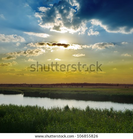 cloudy sunset over river - stock photo