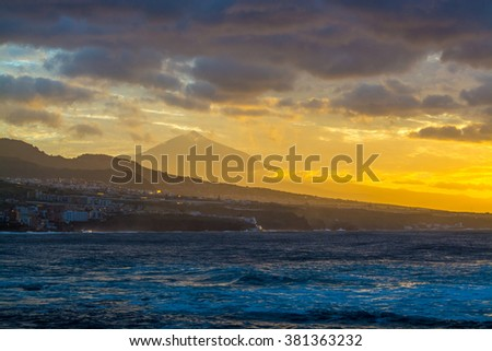 Cloudy sunset with mountain view and ocean