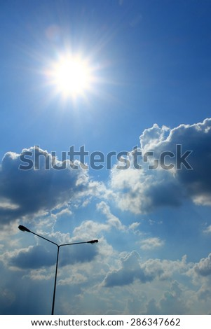 Cloudy with afternoon sun - stock photo