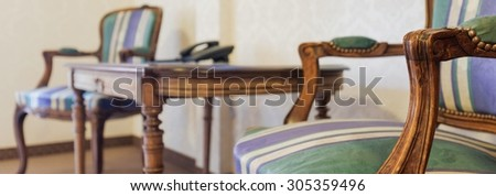 Clouse up view of upholstered vintage style chairs - stock photo