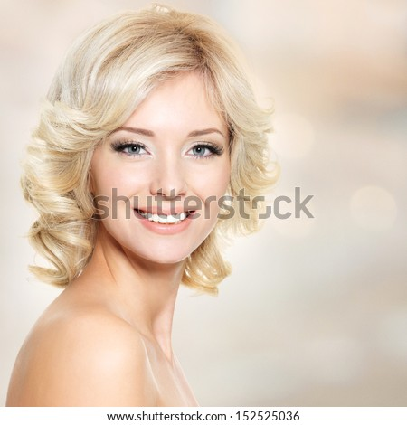Clouseup face of beautiful woman with white hairs over art background - stock photo