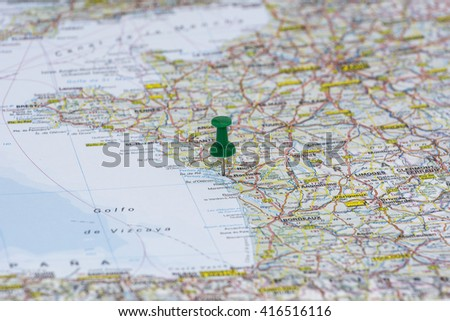 Clouseup of green pushpin on the map - stock photo