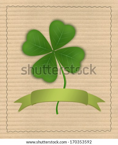 Clover with four leaves with a ribbon on cardboard