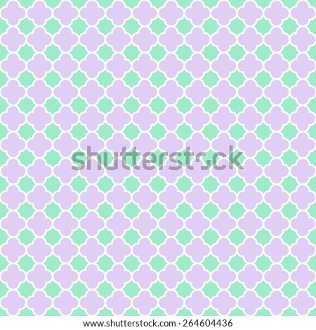 Cloverleaf quatrefoil lattice pattern with white lattice on a lilac purple and mint green background. This is a seamlessly repeating pattern background. - stock photo