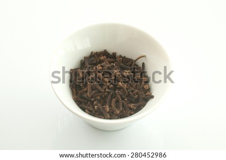 cloves in white cup - stock photo