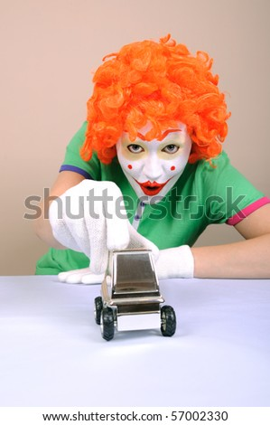 Clown and metal car model - stock photo