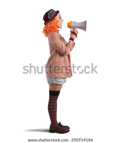 Clown announces the start of the show - stock photo