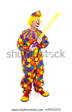 Clown blows up a special balloon for making balloon animals.  Full body isolated on white. - stock photo